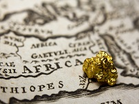 gold nugget on old map of AfricaABN